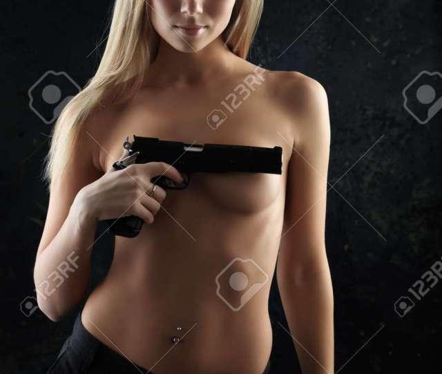 Shot Of A Beautiful Girl Holding Gun Stock Photo 4126120