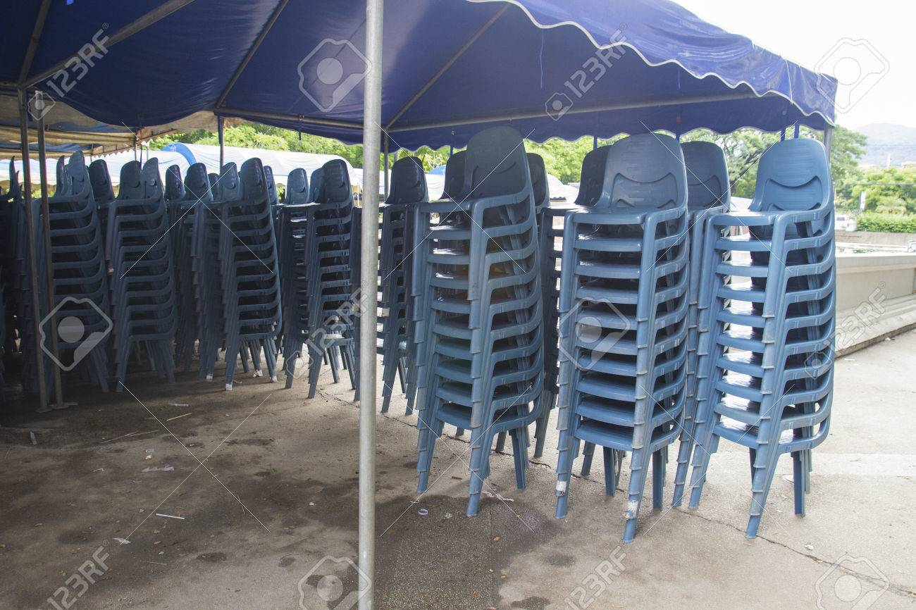 Stack Of Blue Plastic Chair For Banquet In A Tent