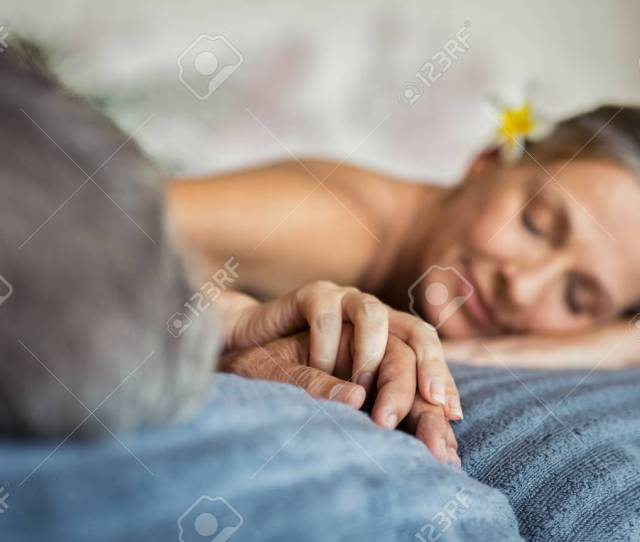 Mature Couple Holding Hands During Romantic Massage At Wellness Center Closeup Hands Of Senior Man