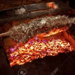 Grilled Meat In Foil On An Open Fire Whole Body Animal Wrapped Stock Photo Picture And Royalty Free Image Image 147186542