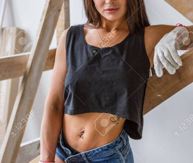 Beautiful Girl Sexy Fitness Makes Repairs In A Bright White Room Stock Photo 78748413