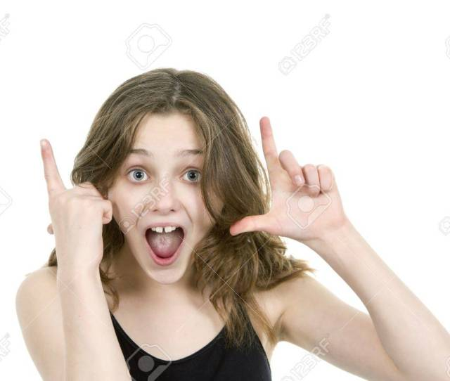 Pre Teen Young Girl Looking At Camera Making Hand Gestures Stock Photo 18437399