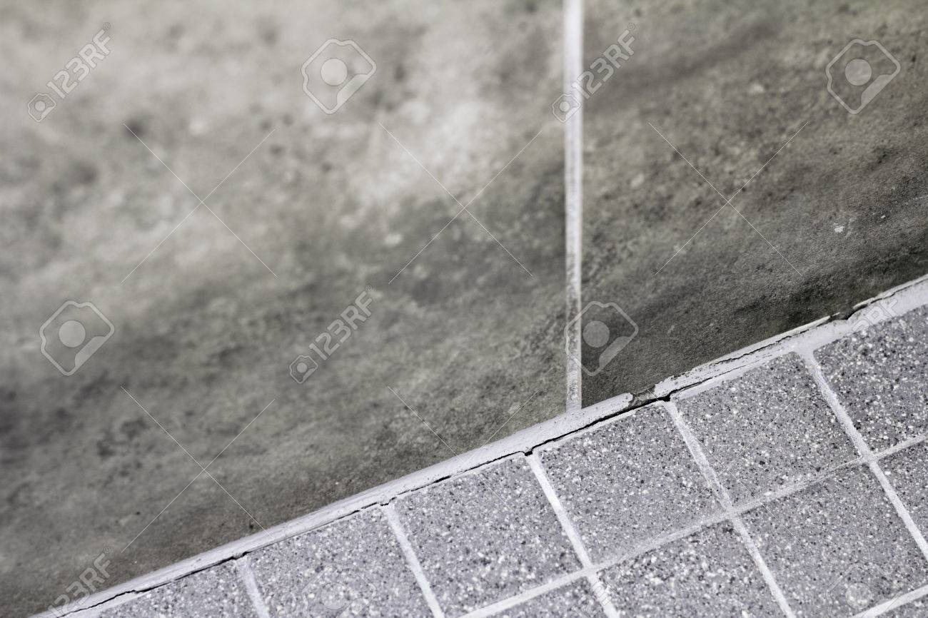 gray tile grout in a home shower that has broken apart and needs stock photo picture and royalty free image image 75723557
