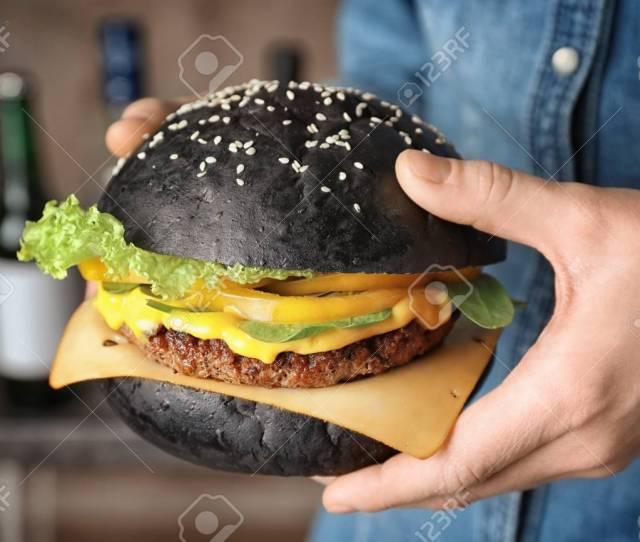 Woman Holding Tasty Black Burger Closeup Standard Bild 112619769