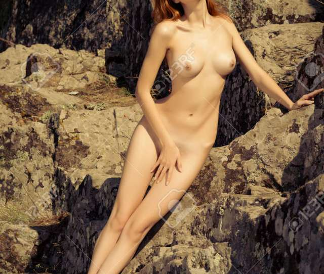 Nude Girl Posing In Nature Near The River Stock Photo