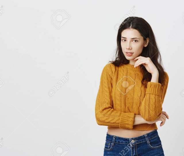 Stock Photo Studio Portrait Of Hot European Female In Yellow Cropped Top Standing In Seductive Pose With Half Opened Mouth And Hand Near Face