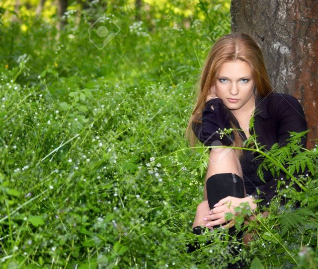 Sexy Girl In Black Boots In The Green Spring Forest Stock Photo