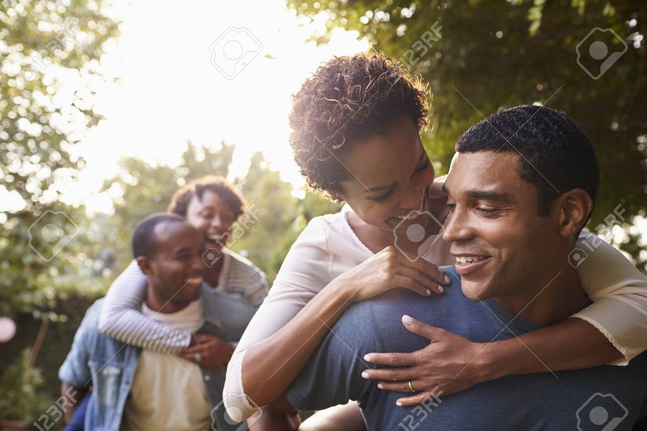 Stock Photo Two Young Adult Black Couples Having Fun Piggybacking