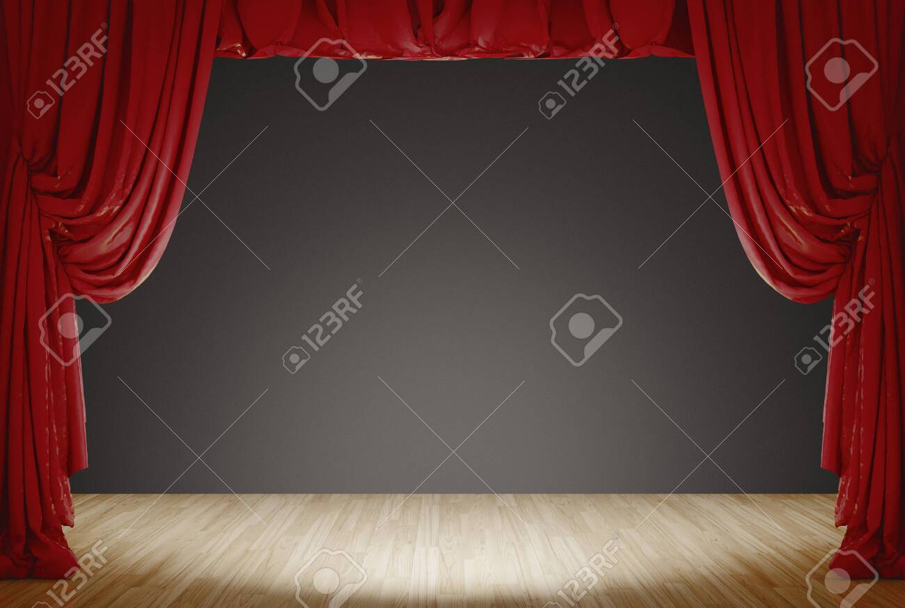 bright stage with red velvet theater curtains and grey background