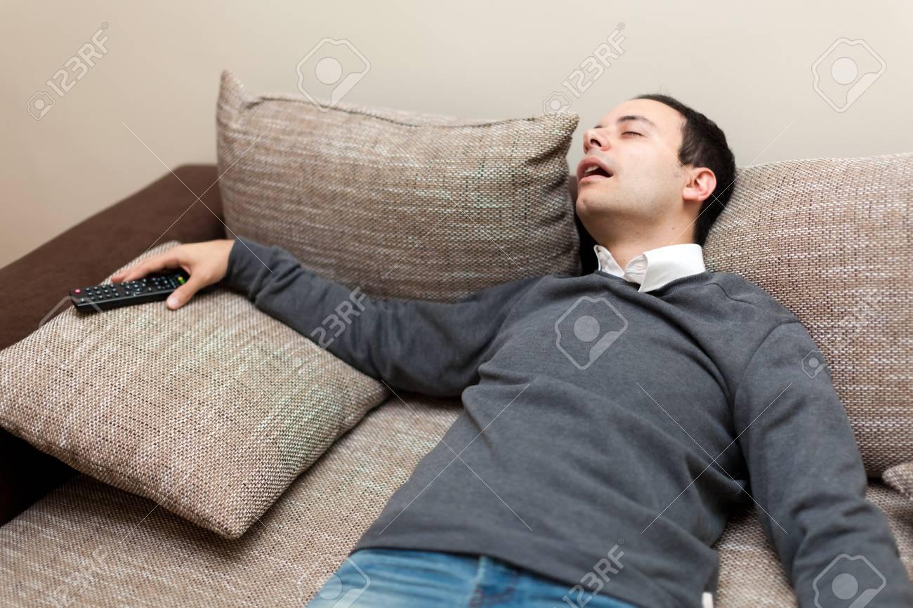 man sleeping while watching tv