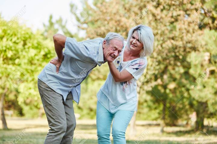 Woman Helps Old Man With Back Pain In The Park In Summer Stock Photo,  Picture And Royalty Free Image. Image 73083056.