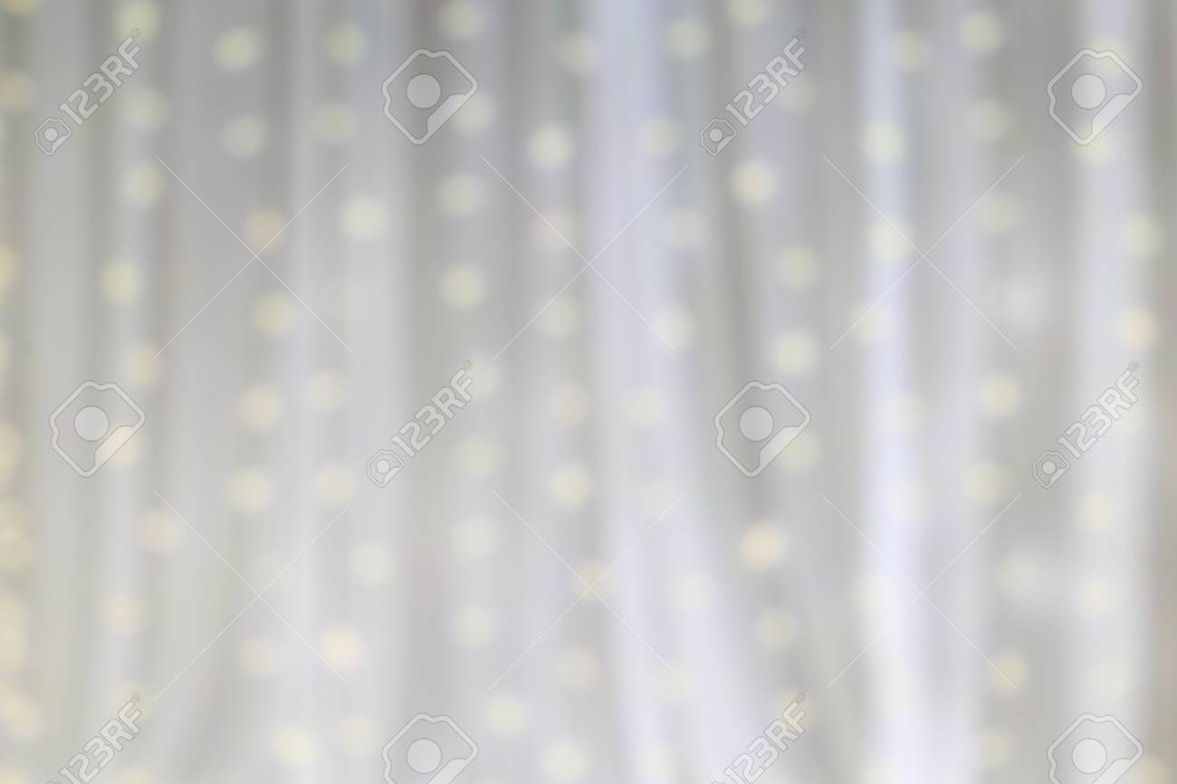 led light on white cloth curtain backdrop defocus white light
