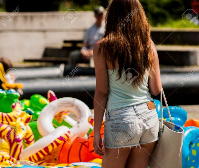 Stock Photo Szczecin Poland Mai   Sexy College Girl Body In Jeans Shorts Girl Is Back Great Ass Background Inflatable Beach Toys