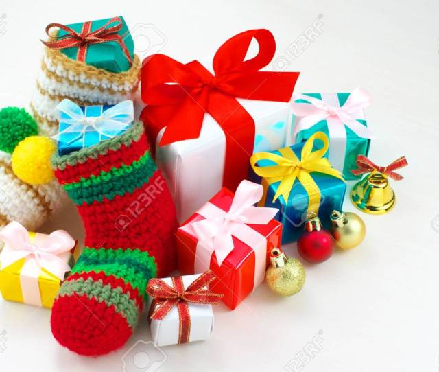 Small Christmas Presents Christmas Stockings And Christmas Balls Stock Photo