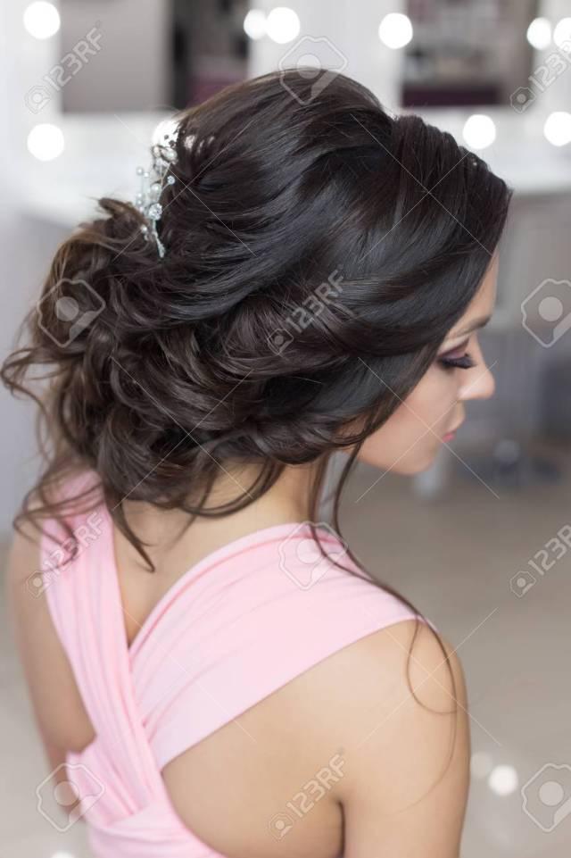 beautiful elegant evening hairstyle on dark hair beautiful girl..