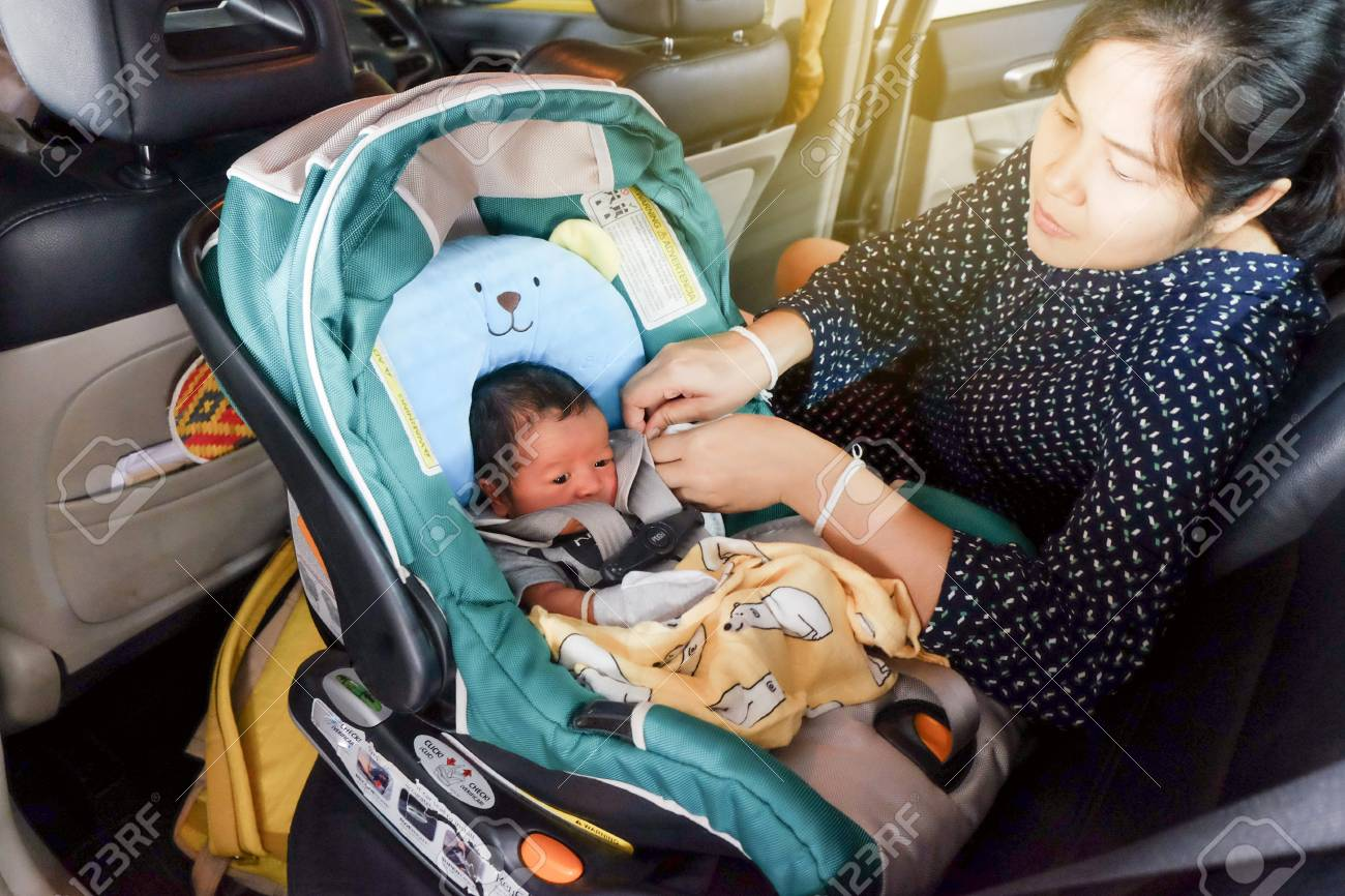Mom With Infant Child Boy Inside Savfty Car Seat Go To Hospital Stock Photo Picture And Royalty Free Image Image 125201763