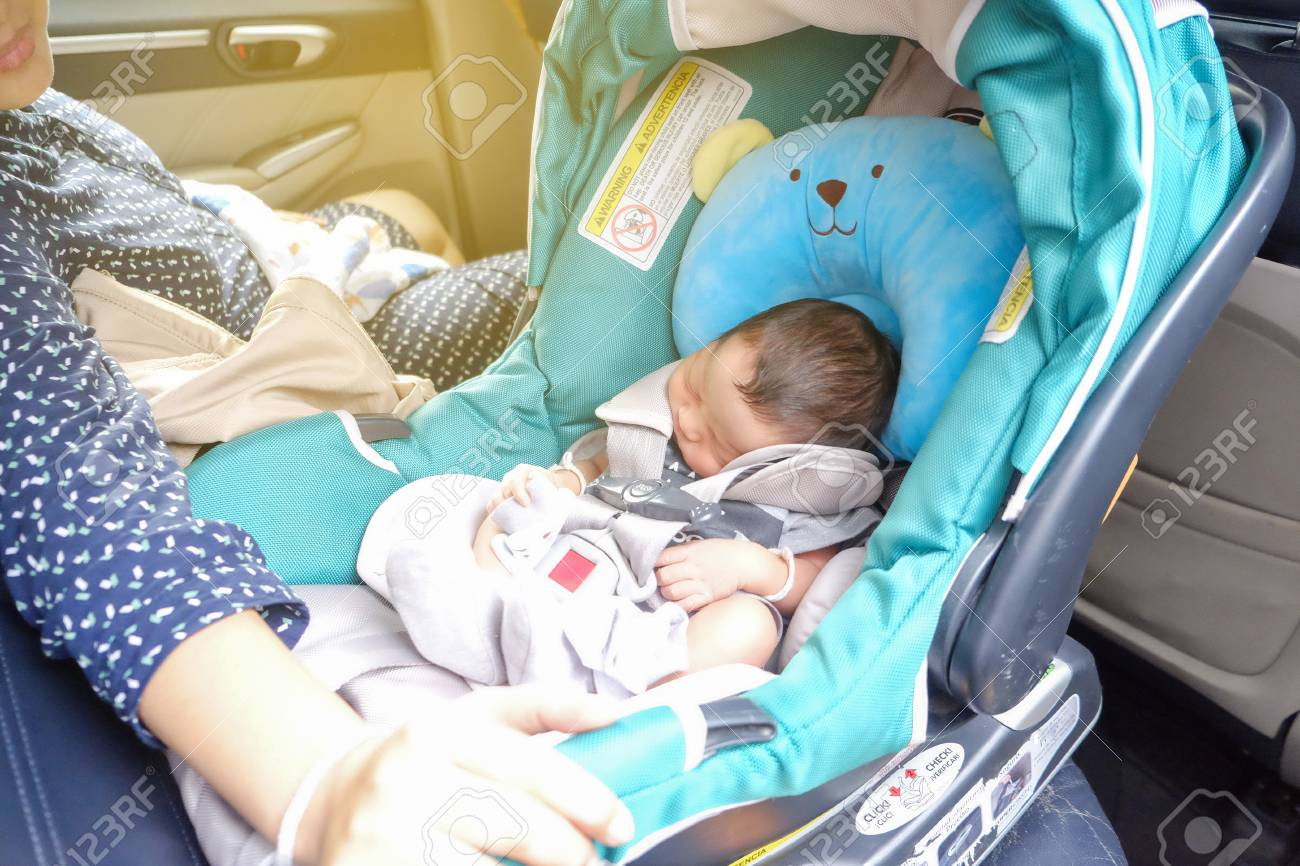 Mom With Infant Child Boy Inside Savfty Car Seat Go To Hospital Stock Photo Picture And Royalty Free Image Image 125111012