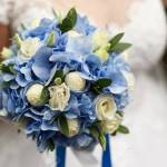 Bride Holds In Her Hand A Beautiful Wedding Bouquet Of Roses Stock Photo Picture And Royalty Free Image Image 114330551