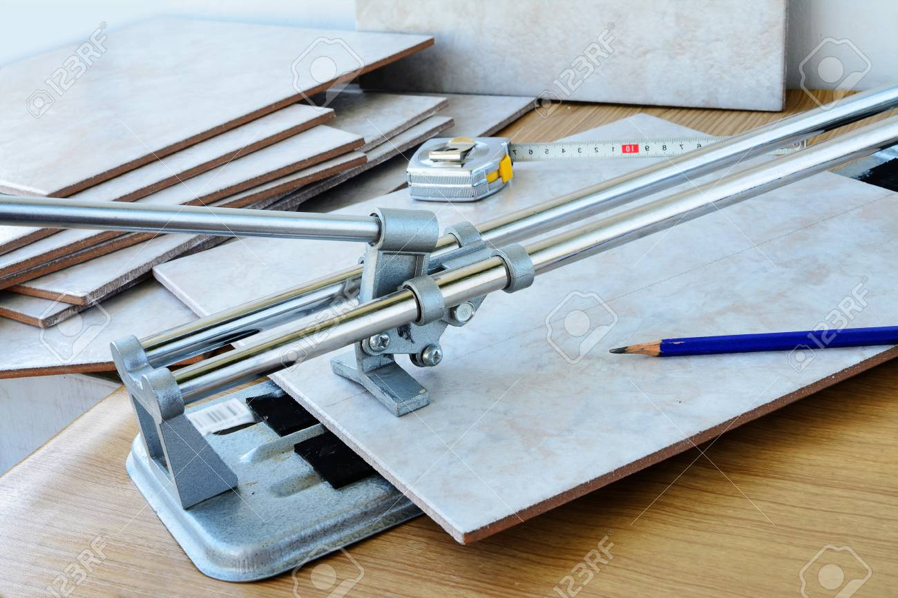 cutting ceramic tiles with manual tile cutter machine diy home stock photo picture and royalty free image image 77400039