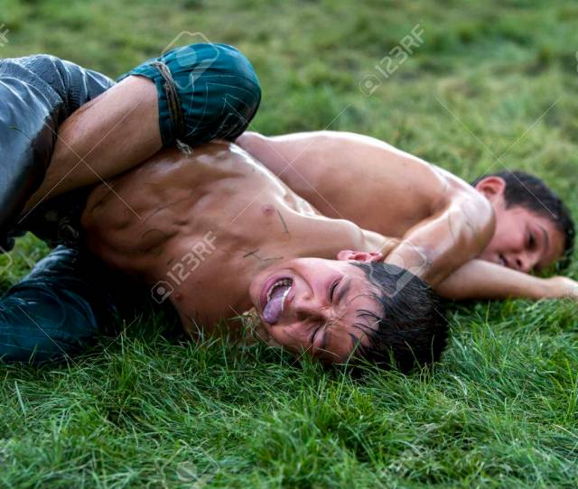 A Young Wrestler In Extreme Pain Is Forced To Concede Victory To His Opponent At The