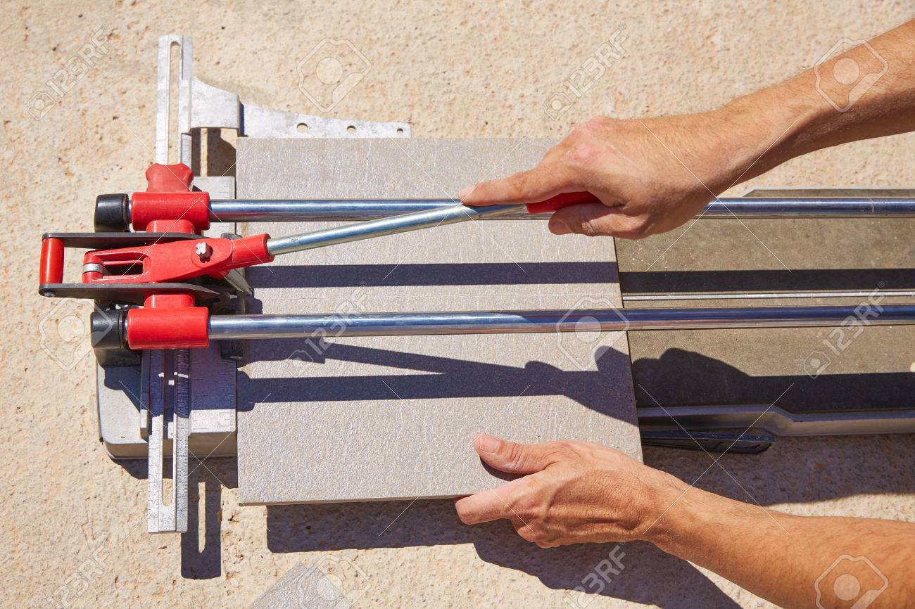 tile cutter machine with mason hands cutting tiles stock photo picture and royalty free image image 41313762