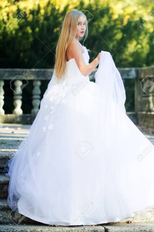 pretty sensual thoughtful young bride girl with long blonde hair..