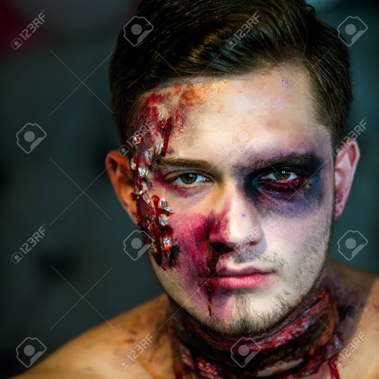 If this describes you, you. Big Zombie Man Halloween Vampire Or Bloody War Soldier With Wounds And Red Blood With Pumpkin