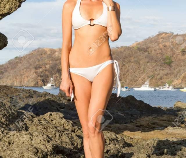 Full Length Portrait Of Young Beautiful Tanned Girl In Bikini Stock Photo