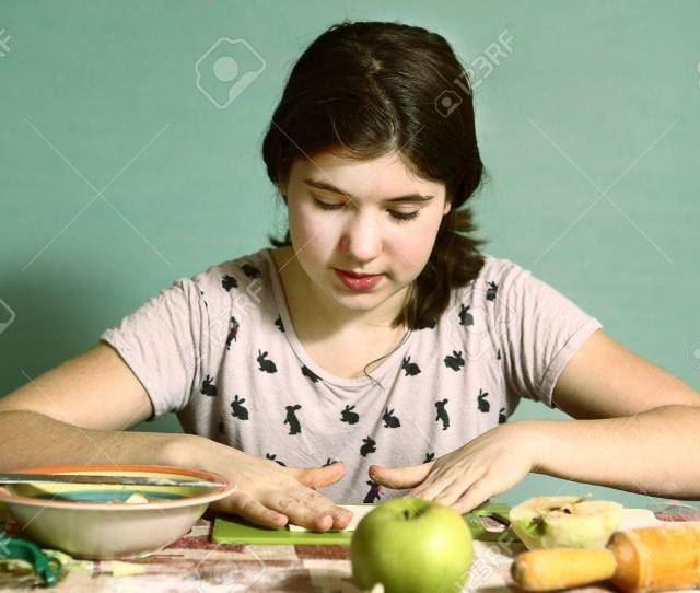 Stock Photo Teen Pretty Girl With Long Dark Hairs Prepare Pies With Cut Apples