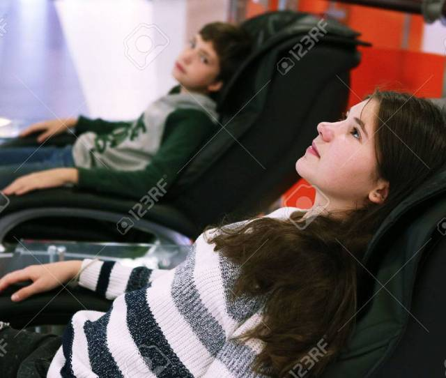 Stock Photo Teen Siblings Brother And Sister In Massage Chair In Shopping Mall