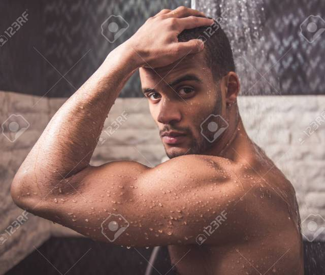 Handsome Naked Afro American Man Is Looking At Camera Taking Shower Stock Photo 72396827