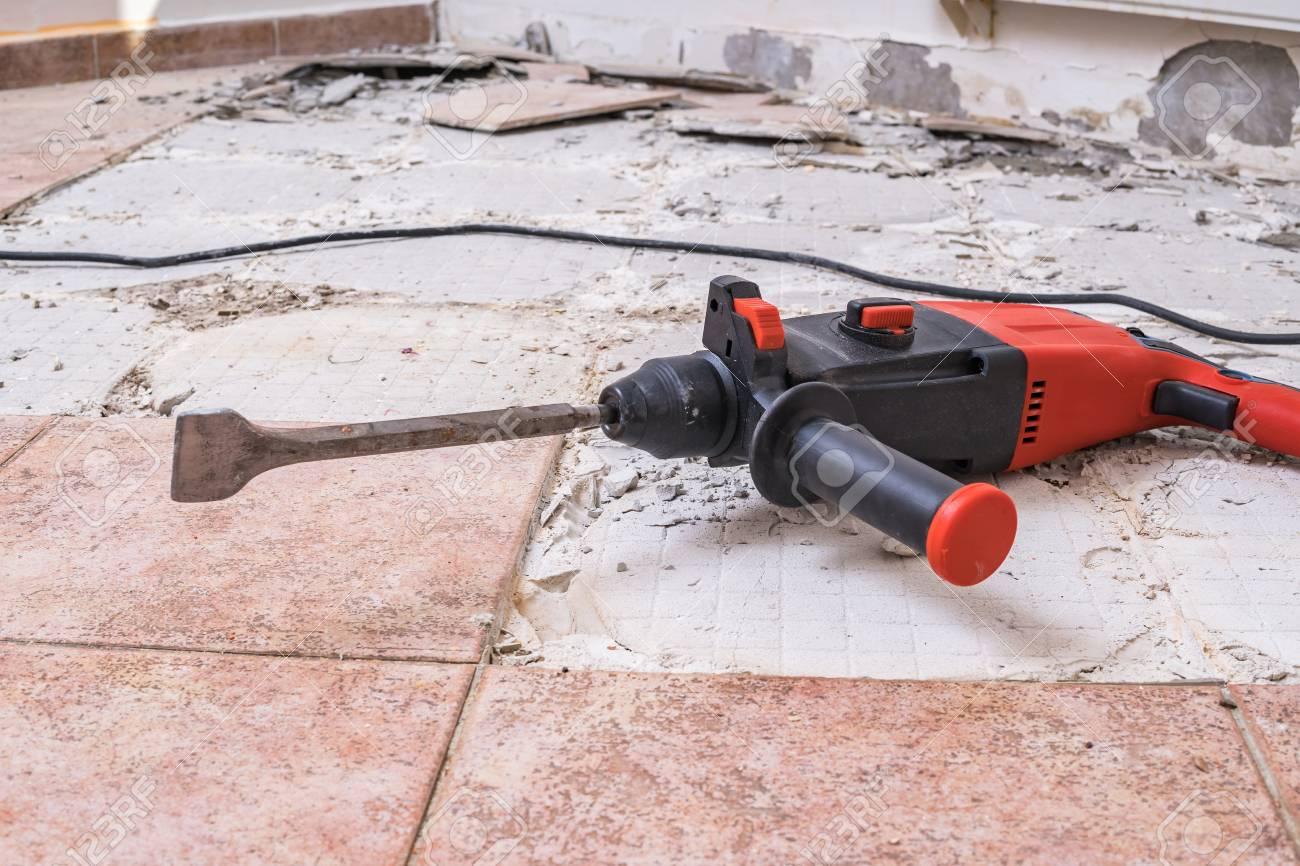 removing old tiles jackhammer drilling demolition hammer on