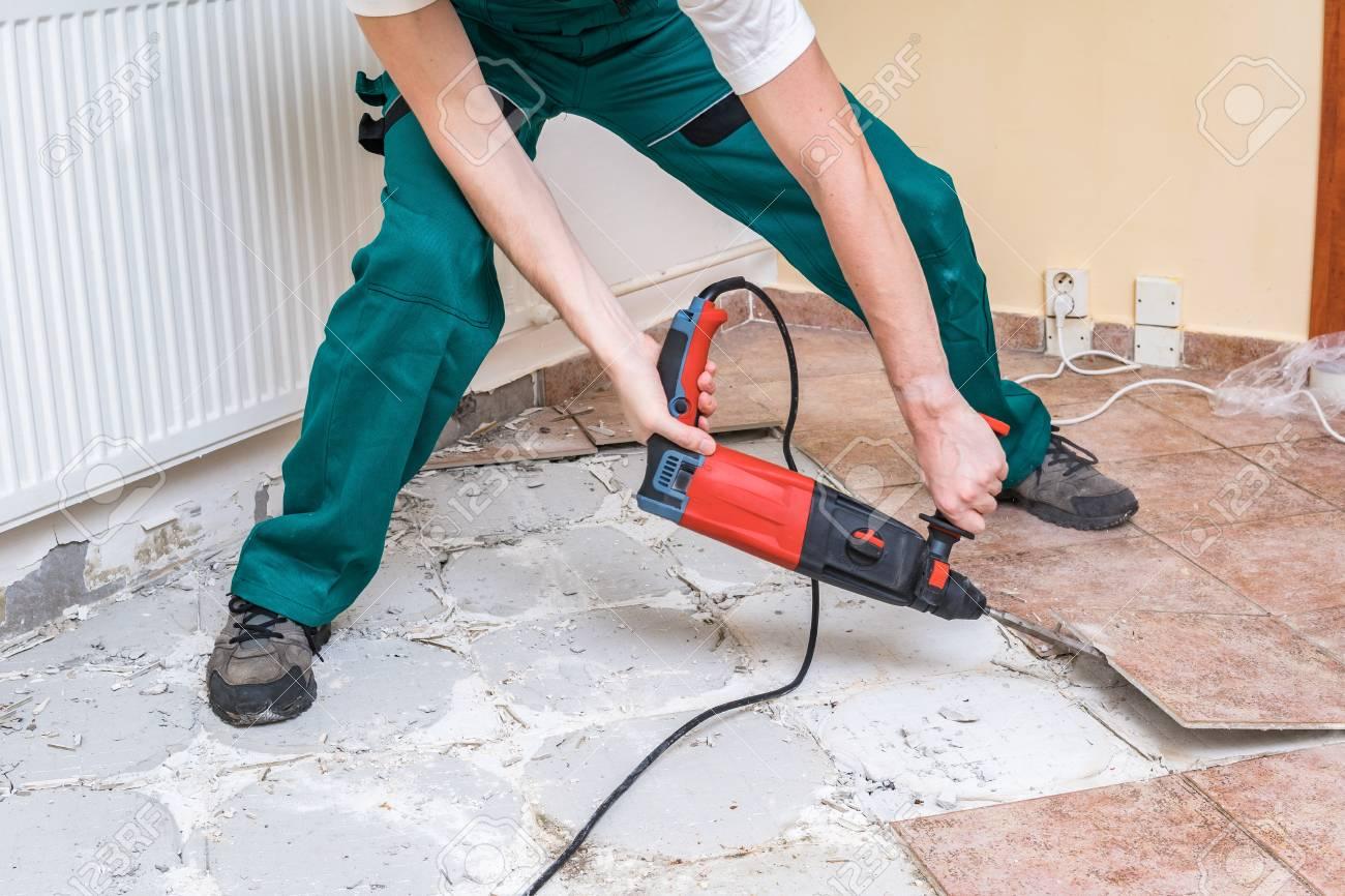 renovation of old floor demolition of old tiles with jackhammer