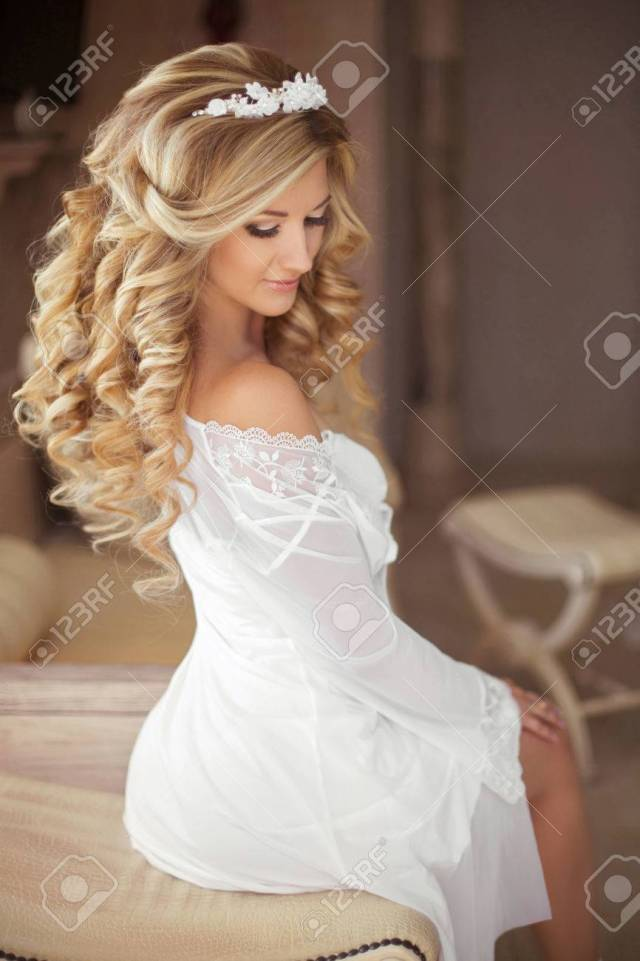 healthy hair. beautiful smiling bride with long blonde curly..