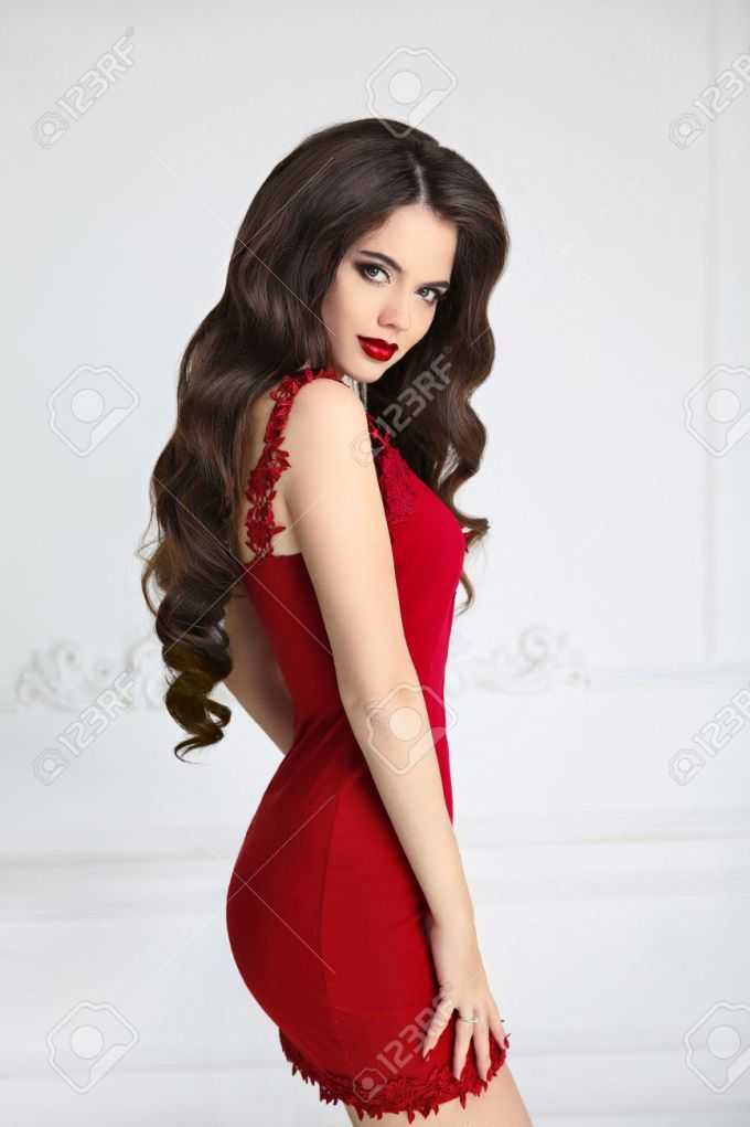 elegant brunette sexy woman in fashion red dress. attractive..