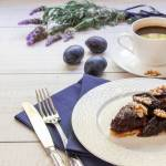 Right Plum Cake On A White Plate Next To A Cup Of Coffee Plums Stock Photo Picture And Royalty Free Image Image 72441364