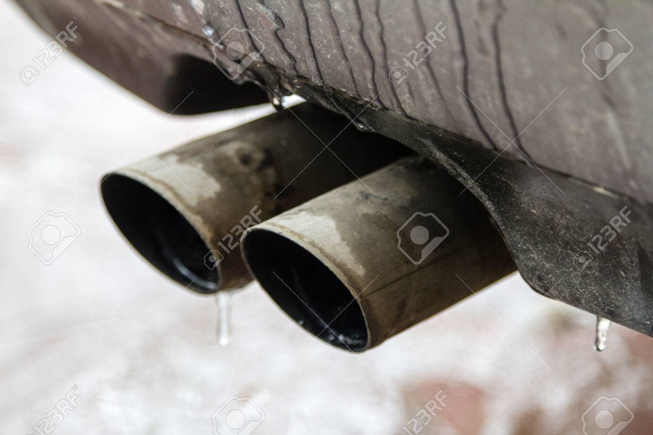 https www 123rf com photo 72674119 dual exhaust pipes under the bumper cars at the idle engine html