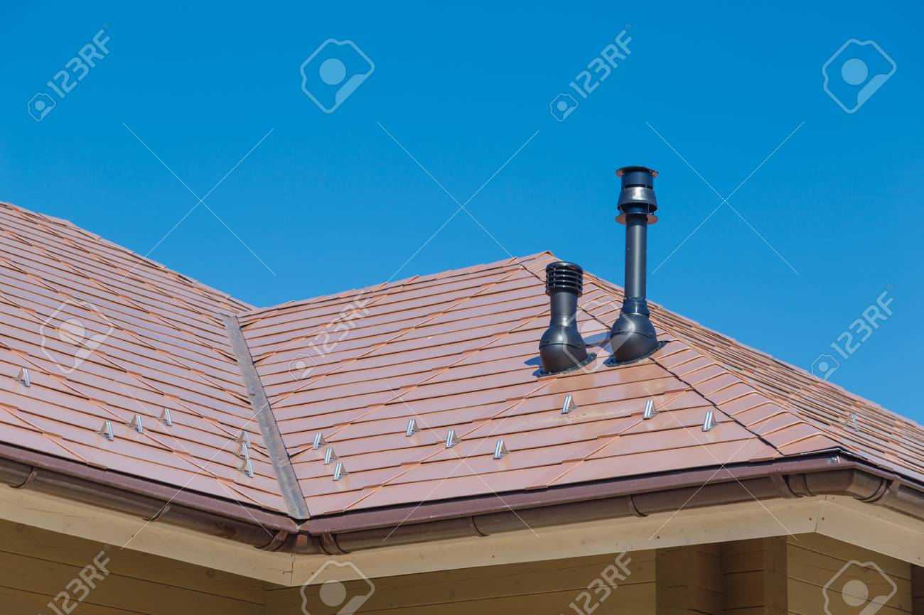 plastic fume hood and exhaust pipe on residential building roof