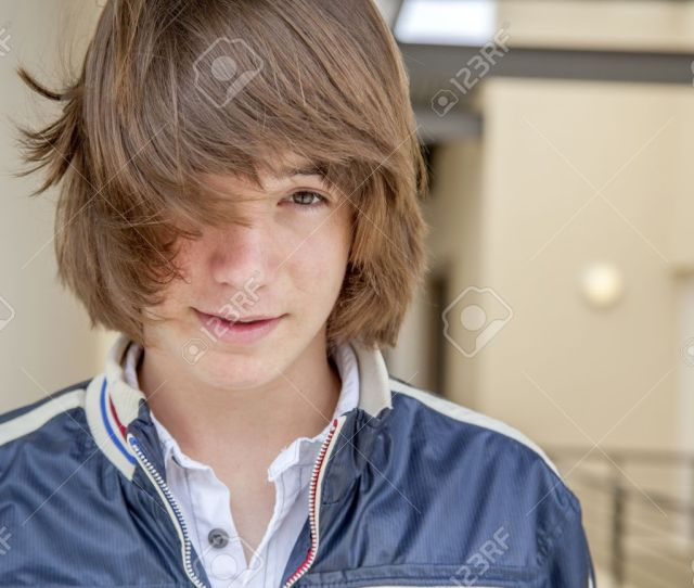 Close Up Of Teen Boy With Long Hair Stock Photo 17495440