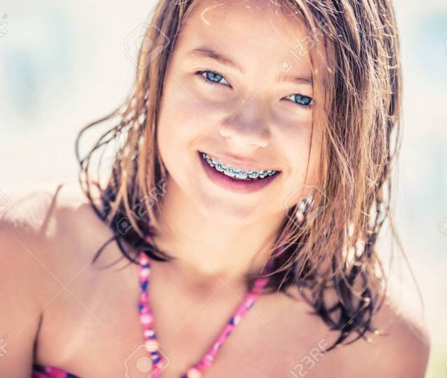 Girl With Teeth Braces Pretty Young Teen Girl With Dental Braces Portrait Of A