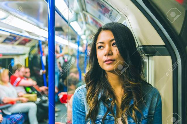 Asian Woman On The Tube In London Beautiful Young Woman Portrait Looking Away From