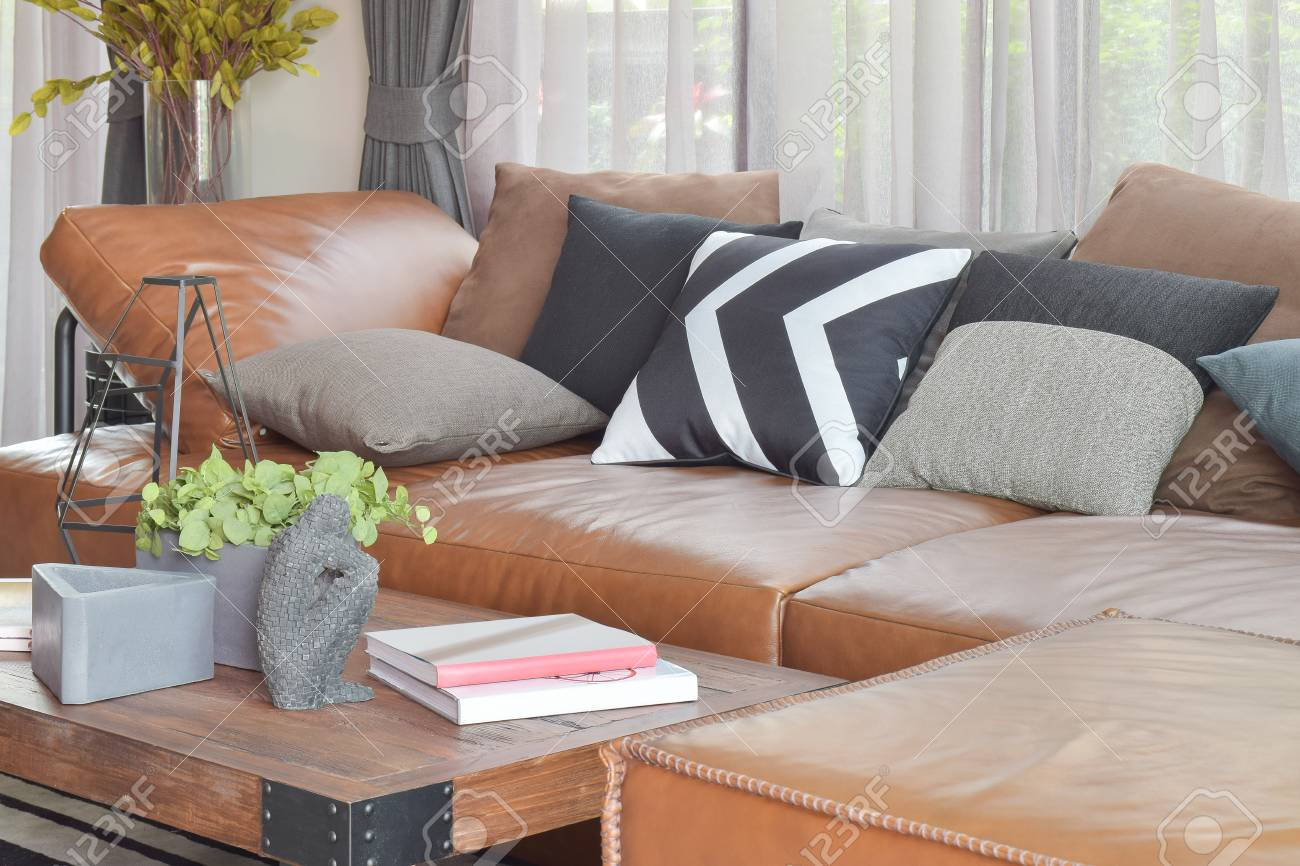 light brown leather l shape sofa and wood table in modern living