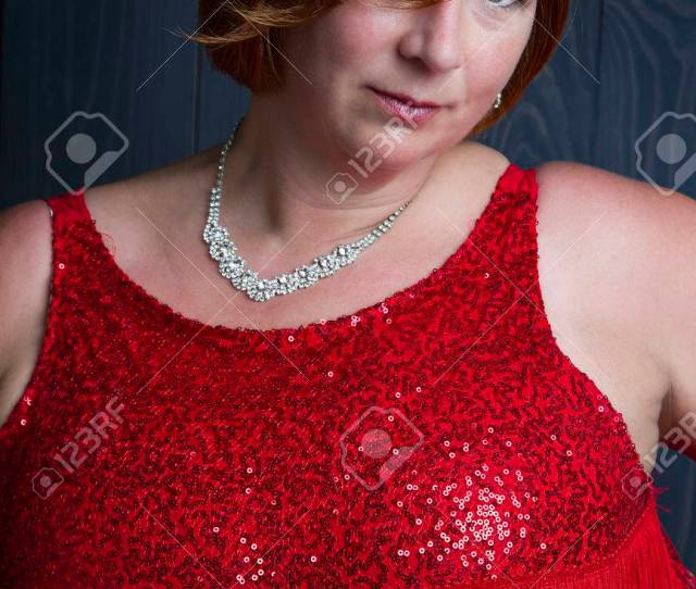 Sexy Forty Year Old Woman Wearing A Sparkly Dress Stock Photo