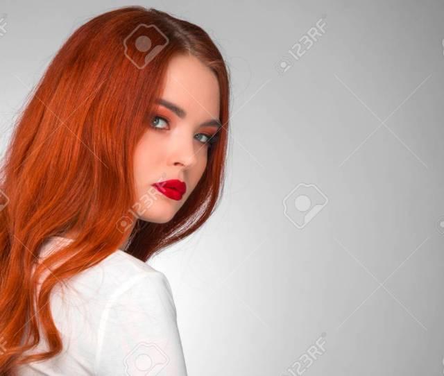Gorgeous Redhead Girl With Wavy Hair Beauty Studio Portrait Stock Photo