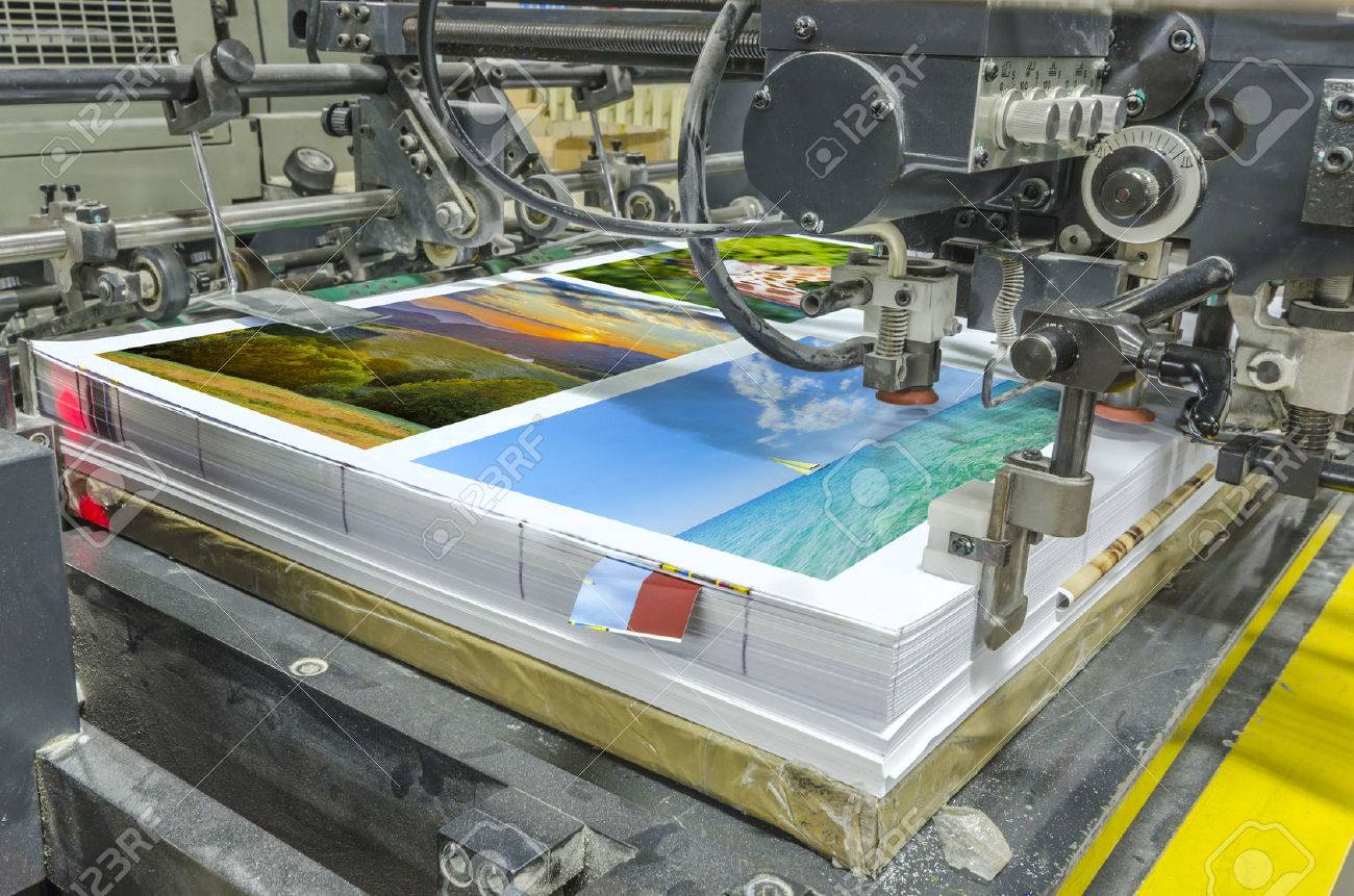 offset machine press print run at table sheeted paper feeder