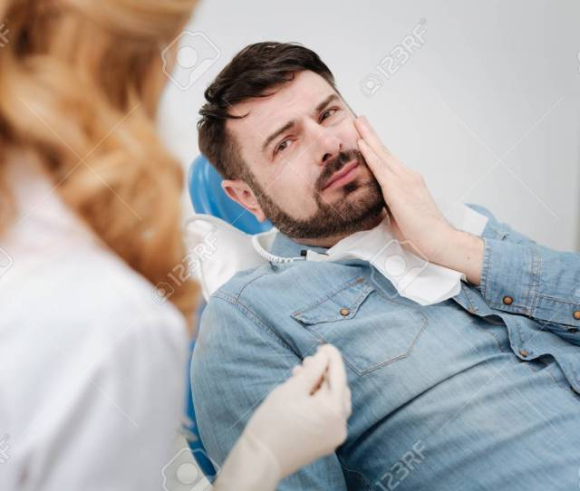 Good Looking Man Experiencing Extreme Pain Stock Photo 75665463