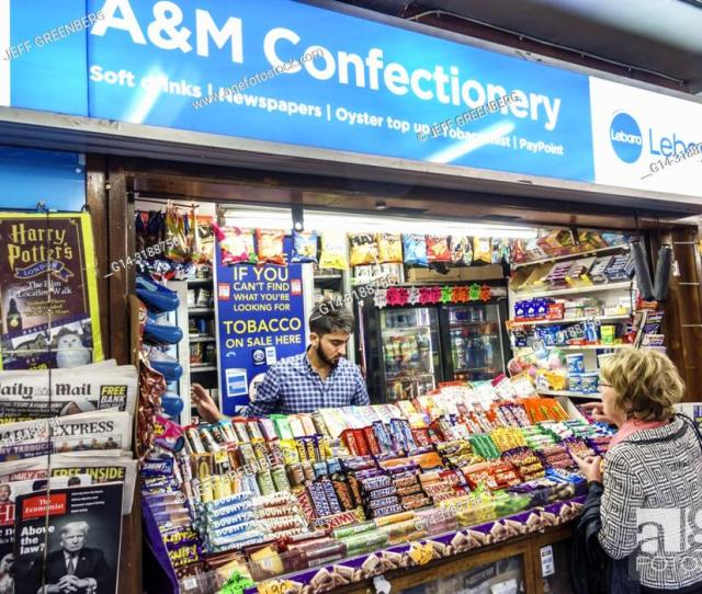 Stock Photo United Kingdom Great Britain England London Kensington South Kensington Underground Station Am Confectionery Newsstand Vendor Stall