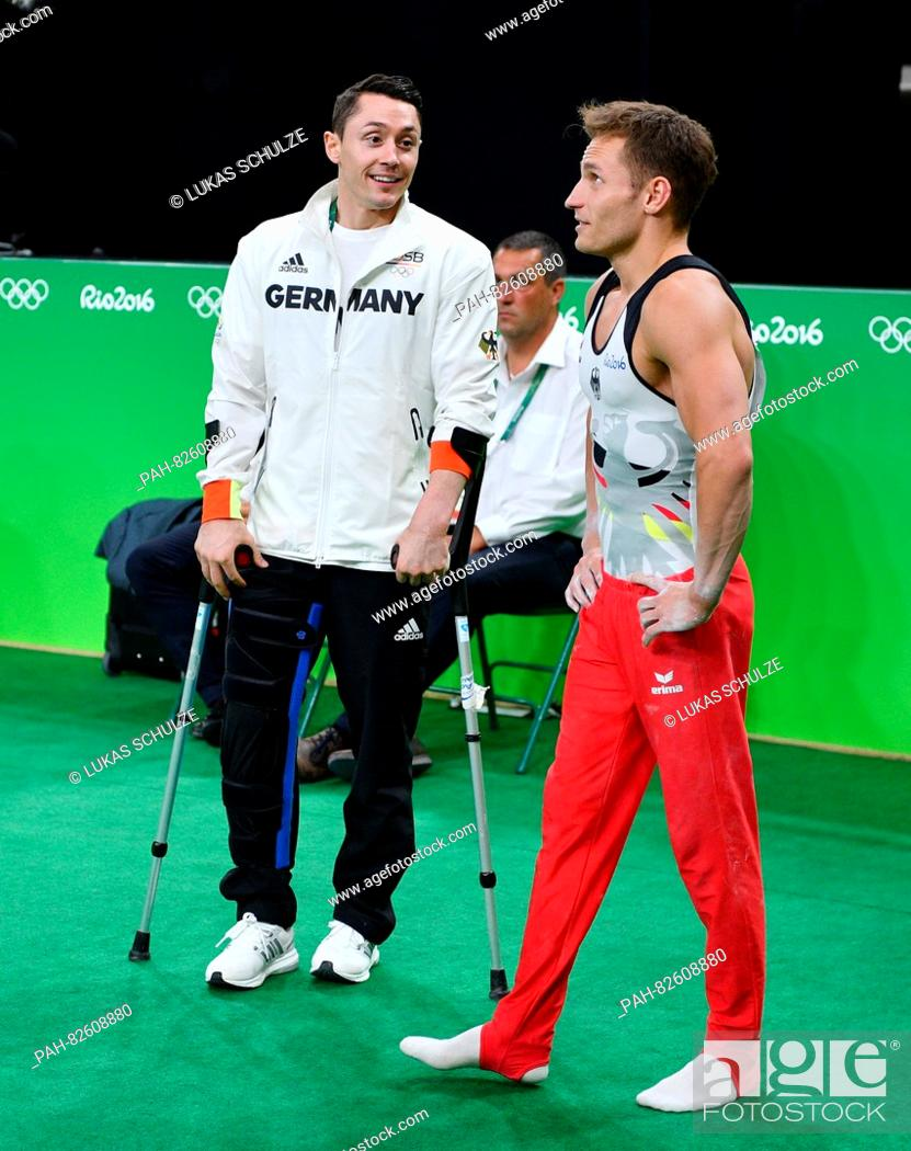 Maybe you would like to learn more about one of these? Injured Gymnast Andreas Toba Of Germany Talks With His Teammate Lukas Dauser R During The Artistic Stock Photo Picture And Rights Managed Image Pic Pah 82608880 Agefotostock