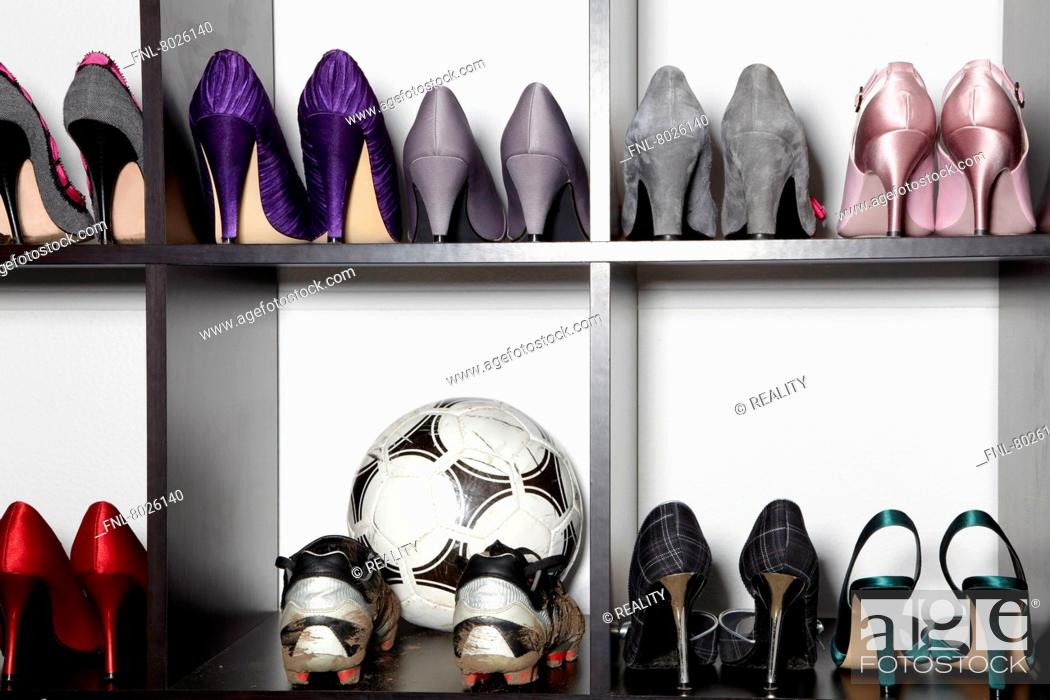 https www agefotostock com age en details photo shoe rack with high heels and soccer boots fnl 8026140