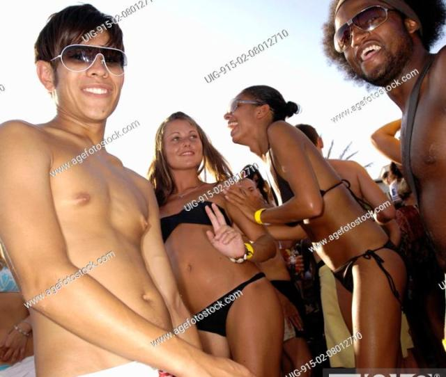 Stock Photo Two Sexy Girls And Two Good Looking Guys Dancing Beach Party